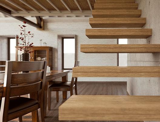 Render de detalle. Escalera con escalones volados en primer plano, al fondo el comedor con madera de nogal y tabiquería de ladrillo blanco pintado.