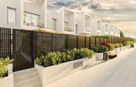 Render exterior del paseo situado justo enfrente de la fila de viviendas en pendiente con zonas ajardinadas.