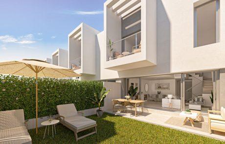 Render exterior desde patio ajardinado, con tumbonas y sombrilla. La vivienda tiene un monocapa gris en la planta baja y monocapa blanco en la planta primera.