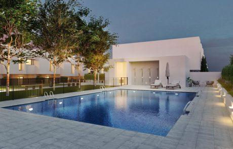 Render exterior de zona de piscina con iluminación de atardecer casi anochecer, con iluminación artificial en el interior y exterior de la piscina.