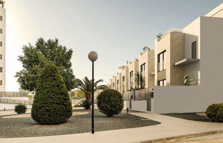 Render exterior donde se ve en primer plano un jardín y al fondo la urbanización.