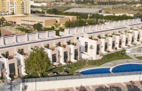 Render aéreo de urbanización donde se muestran las zonas comunes y el conjunto de viviendas.