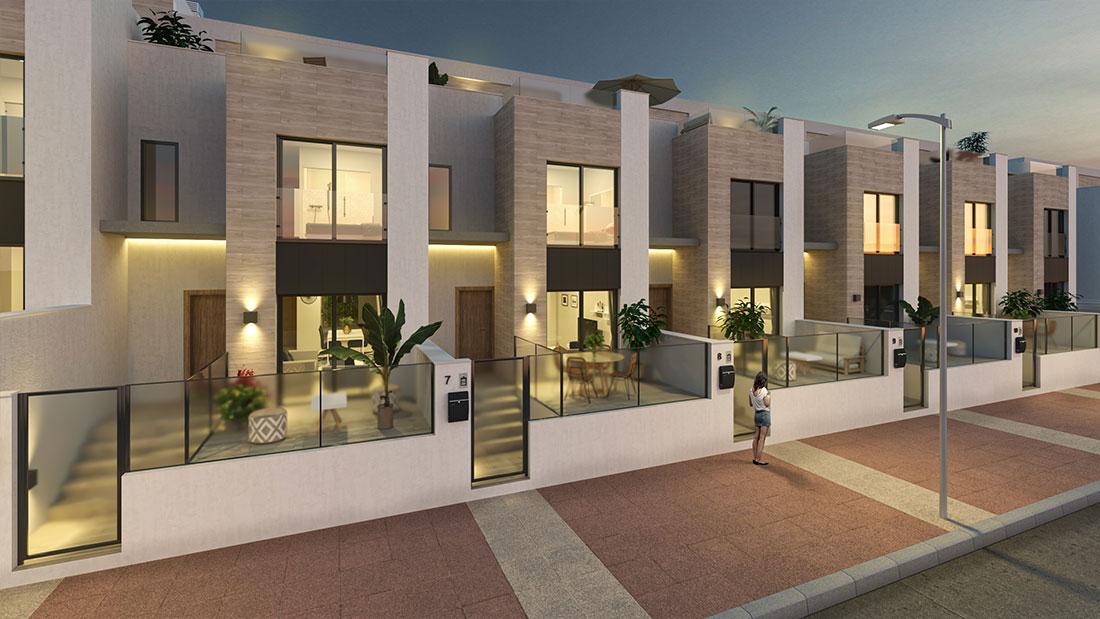 Render exterior de las fachadas de las viviendas con iluminación artificial en el interior y de atardecer anochecer en el exterior.